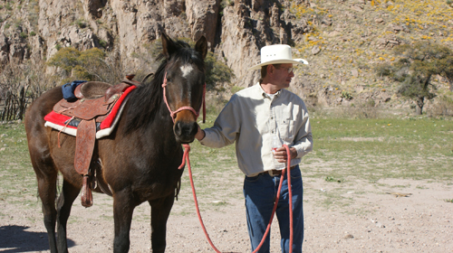 Reed Peters horseback riding at Hideout Ranch